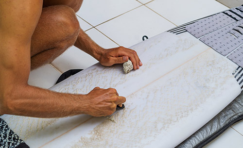 how to clean wax off a surfboard